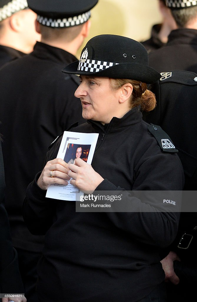 A police officer hold an order of service during the funeral service at St Andrews Cathedral for PC Kirsty Nelis who was killed in the Clutha Bar...