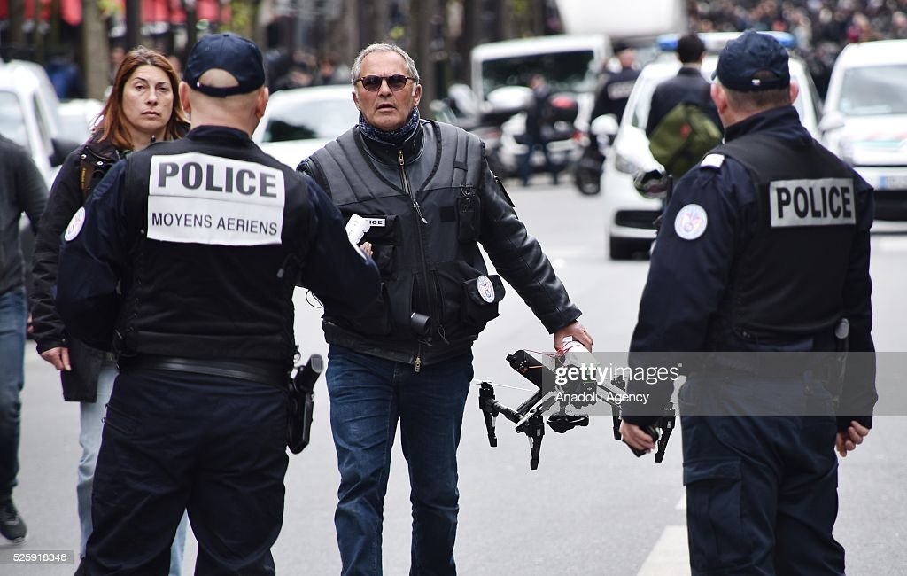 A police officer holds a drone during the protest march, arranged by the French CGT Trade Union, against the government's labour reform proposals in Paris, France on April 29, 2016.