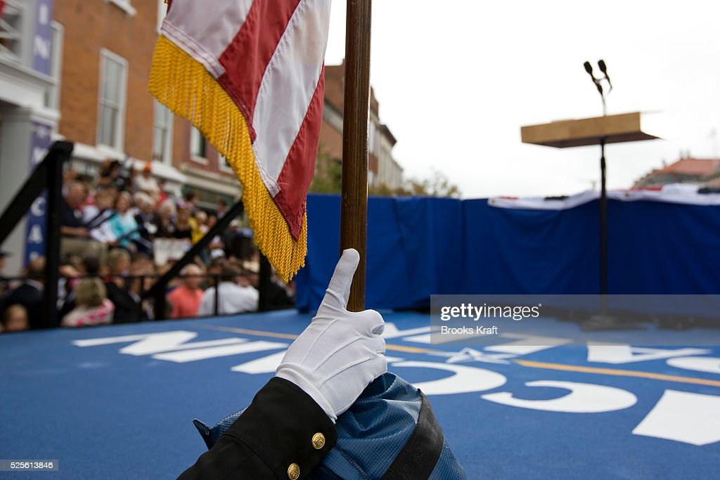 A police officer holds a flag in place on the stage before US Republican presidential nominee Senator John McCain and Republican US vicepresidential...