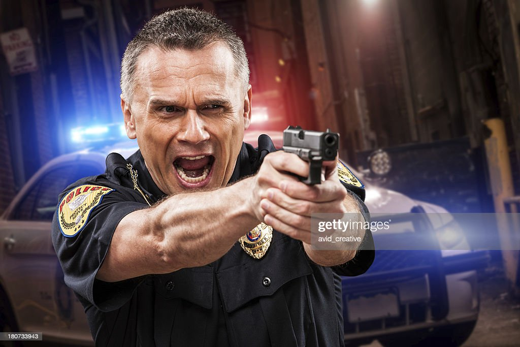 Police Officer In Alley With Gun - 325.6KB