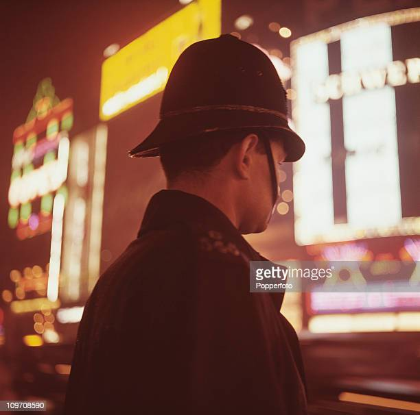 A police officer in Piccadilly Circus London circa 1965