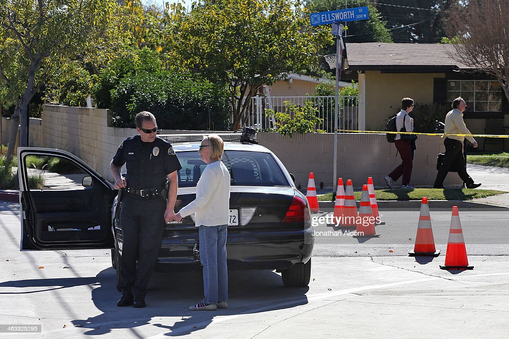 A police officer informs a woman that the evacuation order has yet to be lifted for her neighborhood threatened by the Colby Fire on January 17, 2014 in Azusa, California. The so-called Colby Fire, has burned about 1,700 acres in the Angeles National Forest north of Glendora and Azusa.