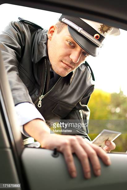 Police officer is doing a traffic check