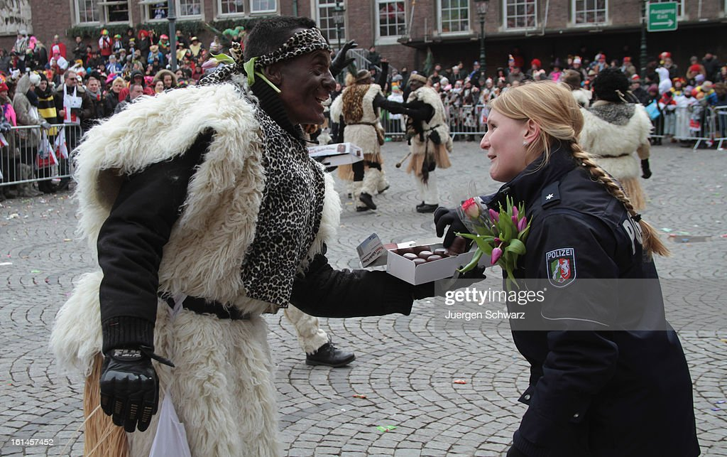 A police officer is given candy by a participant during the annual Rose Monday (Rosenmontag) carnival parade on February 11, 2013 in Dusseldorf, Germany. Rose Monday is the highpoint of the annual carnival season in the region between Mainz, Cologne and Dusseldorf, where carnival has been an annual tradition since 1823 and celebrates free-spirited merrymaking before the beginning of Lent.