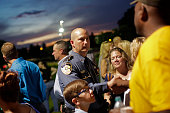 A police officer is greeted during a candlelight vigil for Baton Rouge Police Officer Matthew Gerald at Healing Place Church on July 18 2016 in Baton...