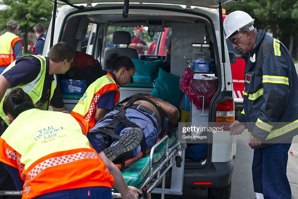 A police officer is injured in a car crash during protest on January 22, 2013, in Sasolburg, South Africa. Government's announcement of its intention to merge municipal systems in the Free State sparked outrage in locals, leading to chaotic protests.