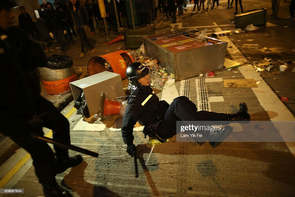A police officer is injured in Mong Kok district of Hong Kong on February 9, 2016 in Hong Kong. More than 40 police officers and journalists have been injured after a riot with protesters on the first day of Chinese New Year celebrations.