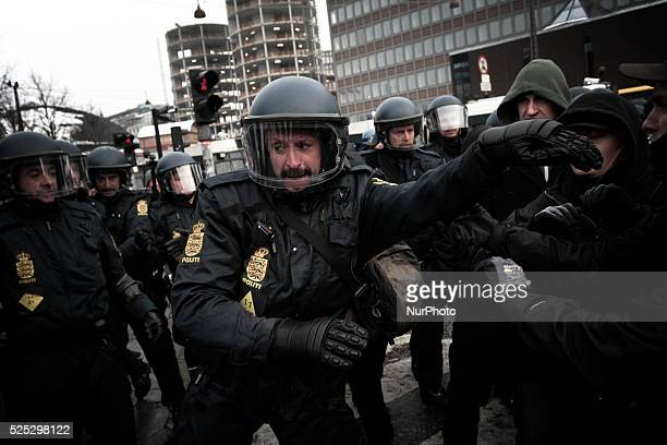 A police officer is knocked over as the police forces attempt to clear the street Clashes between antiislamist protesters and antifascist activists...