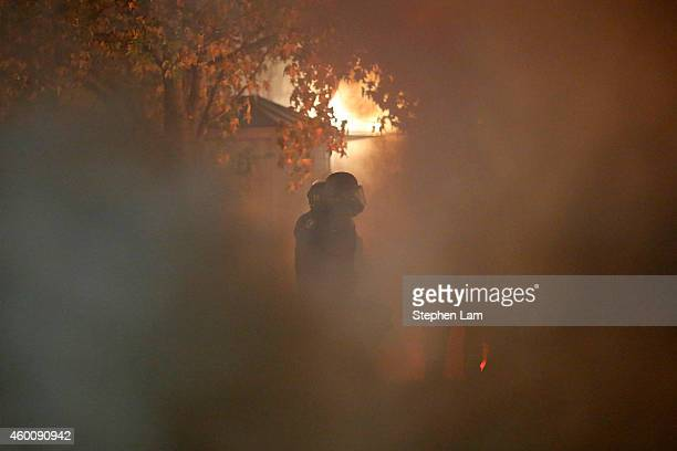 A police officer is seen through a cloud of teargas and smoke during a demonstration over recent grand jury decisions in policeinvolved deaths on...