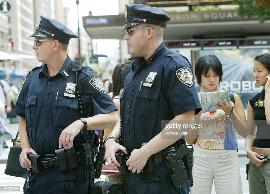 Police officer John Pell (L) and Garrett Pearsal stand patrol in front of Madison Square Garden in an area frequented by tourists as security is beefed up July 4, 2004 in New York City. Although no specific threats have been sited the FBI has sent alerts to police departments nationwide for the holiday weekend.
