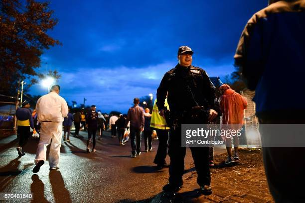 A police officer keeps watch as athletes arrive for the New York City Marathon in New York on November 5 2017 Five days after the worst attack on New...