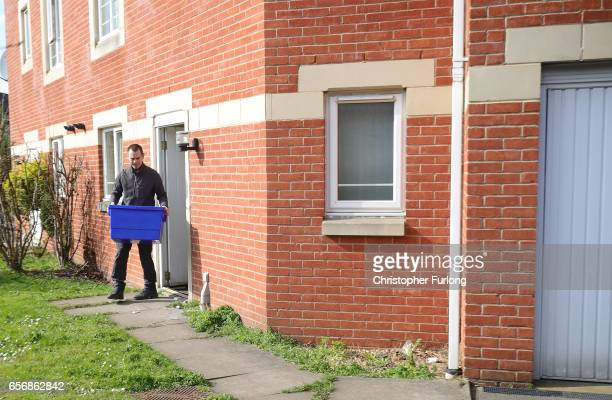 A police officer leaves a home in Quayside Winson Green Birmingham which was raided by antiterror police in connection with the London Terror attacks...