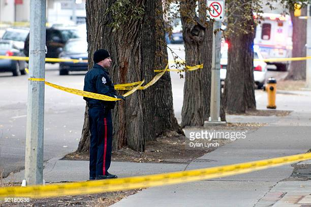 A police officer lines the street with police line during a hostage situation at the Workers' Compensation Board building on October 21 2009 in...