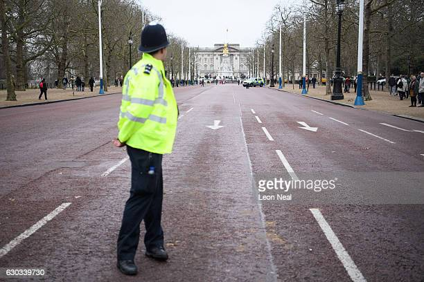 A police officer looks along the closedoff Mall in front of Buckingham Palace ahead of the Changing of the Guard ceremony on December 21 2016 in...