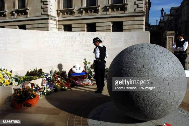 A police officer looks at the memorial to those who died in the Bali bombings four years ago on Clive Steps at Horse Guards Road London after it was...