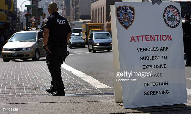 A police officer looks out for trucks to call in for inspection June 5 2007 in New York City The New York Police Department set up a morning...