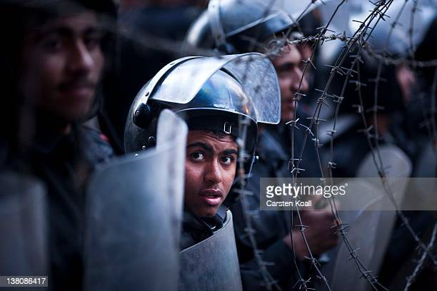 A police officer looks out from a police barricade as the police stop demonstrators on their way to the interior ministry after a demonstration...