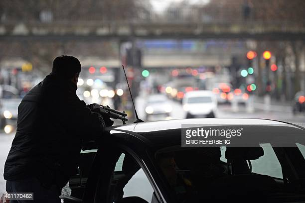 A police officer mans a position at the Porte de la Villette road hub in Paris on January 8 2015 after a policewoman was killed and a city employee...