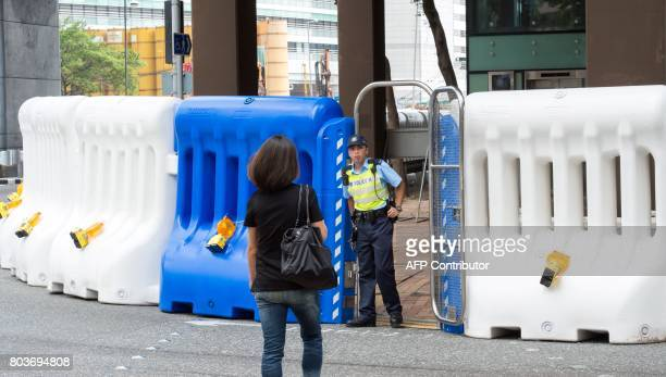 A police officer mans a security gate in place during Chinese President Xi Jinping's visit in Hong Kong on June 30 2017 Xi arrived in Hong Kong on...