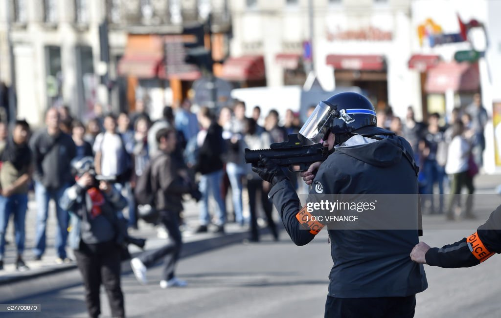A police officer of France's anti-criminality brigade (BAC) takes position during a protest against the government's planned labour law reforms in Nantes, western France, on May 3, 2016. High school pupils and workers protested against deeply unpopular labour reforms that have divided the Socialist government and raised hackles in a country accustomed to iron-clad job security. / AFP / LOIC