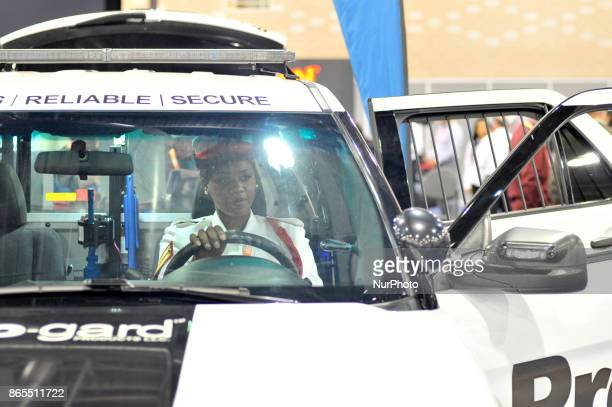 Police Officer of the Bahama's sits in a police vehicle at the law enforcement expo part of the annual International Association of Chiefs of Police...