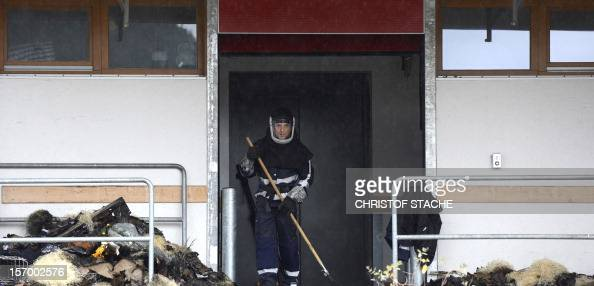 A police officer of the forensics unit works at the scene of a fire at a workshop for handicapped people in Titisee Neustadt southern Germany on...
