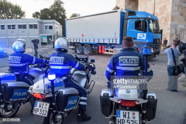 Police officer on motorbikes watch the Truck with the defused World War II bomb in Frankfurt Germany on September 03 2017 More than 60000 people was...