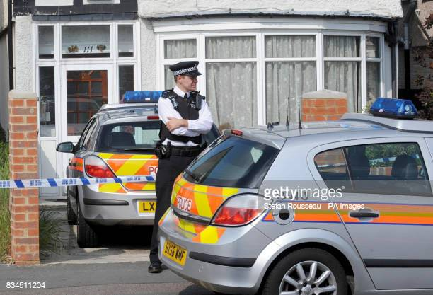 A Police Officer outside Number 111 Park Lane in Carshalton where a fiveyearold boy and a fouryearold girl have died from suspected stab wounds A six...
