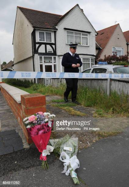 A Police Officer outside Number 111 Park Lane in Carshalton where a fiveyearold boy and a fouryearold girl have died after being found with serious...