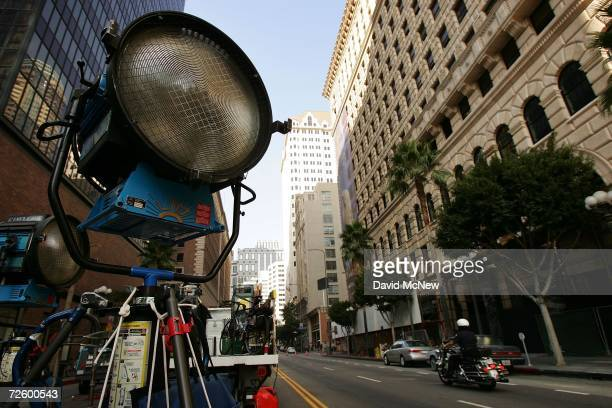 A police officer passes lights used in an auto insurance commercial onlocation downtown on November 18 2006 in Los Angeles California A report...