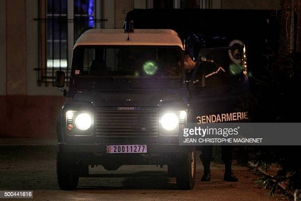 A police officer patrols on December 8 2015 in La Mole near the city of SaintTropez southeastern France during the search for the murderer of a...