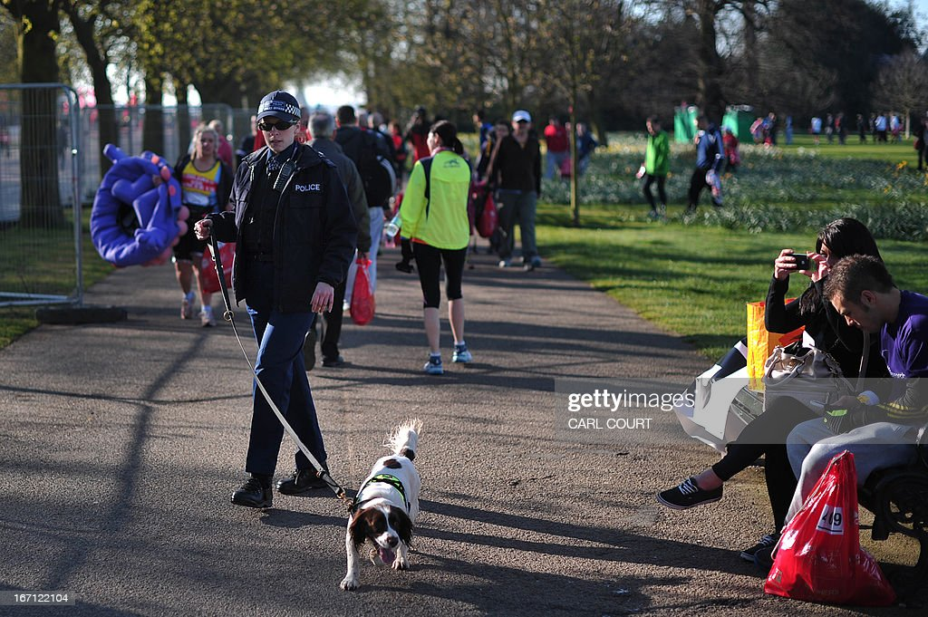 A police officer patrols with a sniffer dog in Greenwich Park in southeast London on April 21, 2013 ahead of the 2013 London Marathon.