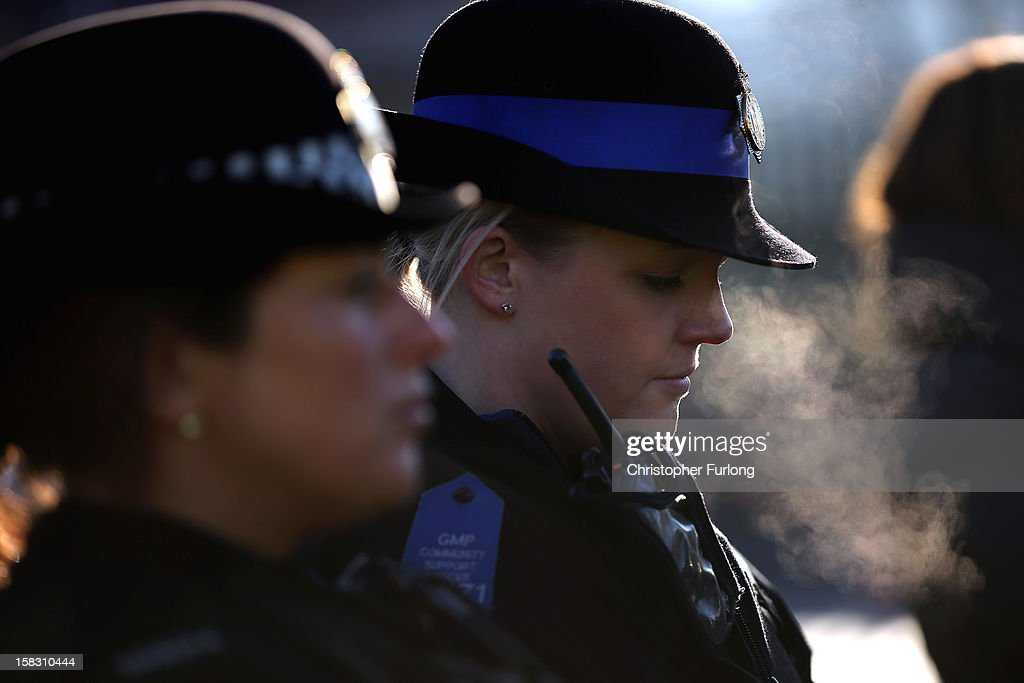 A police officer pauses for thought in the memorial garden dedictated to murdered PC's Fiona Bone and Nicola Hughes, which was unveiled today on December 13, 2012 in Hyde, England. Police Constables Fiona Bone, 32, and her colleague Nicola Hughes, 23, were killed as they responded to what they thought was a routine burglary call in Mottram, Greater Manchester and were murdered in a gun and grenade attack. The memorial garden outside Hyde police station has been created using funds donated by the public, businesses and police partners.