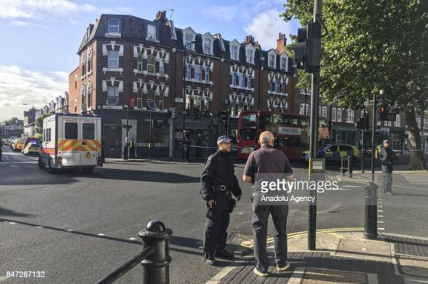 A police officer performs a security check on a man after an explosion at Parsons Green Tube Station in London United Kingdom on September 15 2017