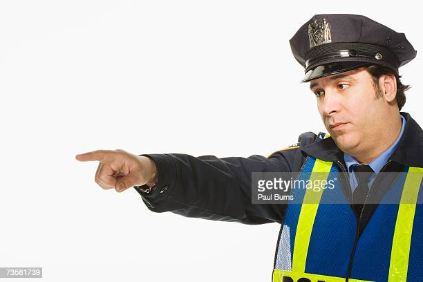 Police officer pointing on white background