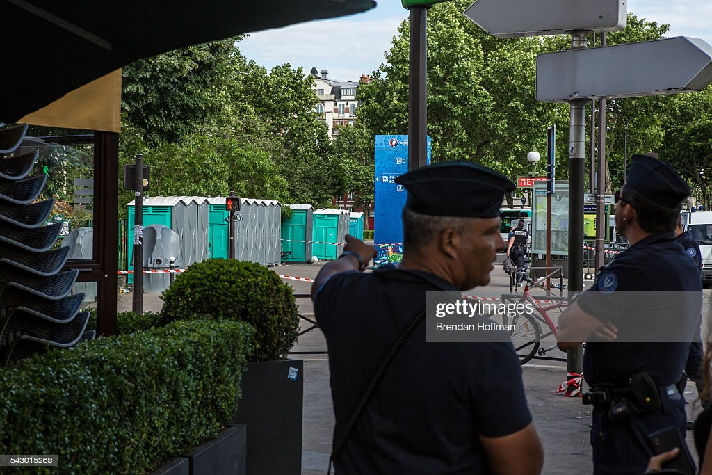 A police officer points at portable toilets suspected of holding a possible bomb near the Parc des Princes stadium during the football match between Wales and Northern Ireland during UEFA Euro 2016 tournament on June 25, 2016 in Paris, France. There was no bomb. The two teams met in the Round of 16 at Parc des Princes in Paris, where Wales won 1-0.