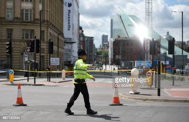 A police officer potrols a cordon near to the Manchester Arena in Manchester northwest England on May 23 2017 following a deadly terror attack at the...