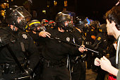 A police officer prepares to confront a protester during a demonstration over recent grand jury decisions in policeinvolved deaths on December 7 2014...