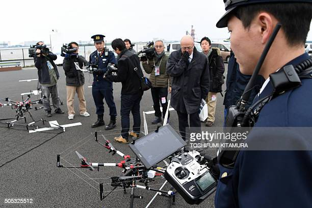 A police officer prepares to fly a drone interceptor during an antiterrorism drill for the upcoming Tokyo marathon at the planned finish area for the...