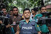 A police officer refuses to speak about the rescue opperation in Gulshan Dhaka Bangladesh on 2 July 2016