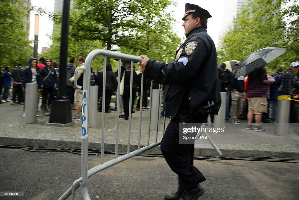 A police officer removes a barricade gate on the grounds of the ground zero memorial site after authorities opened the plaza to the public free of charge on May 16, 2014 in New York City. Prior to today, visitors had to wait in line to enter a barricaded area which includes the newly dedicated National September 11 Memorial Museum. Together with the museum, Ground Zero has become one of the top tourist attractions in the nation with tens of thousands of visitors expected yearly.