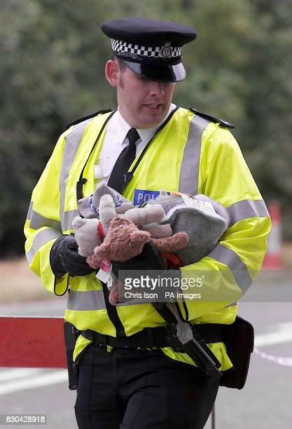A police officer removes some of the many cuddly toys from beside the A29 in Pulborough West Sussex at the request of Sarah Payne's family The body...
