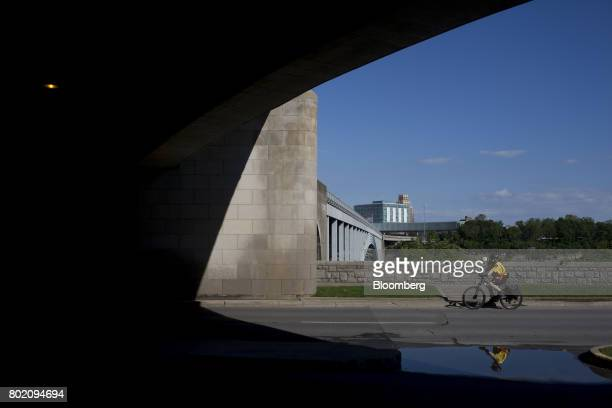 A police officer rides a bicycle past the Niagara Falls International Rainbow Bridge in Niagara Falls Ontario Canada on Wednesday June 21 2017 The...
