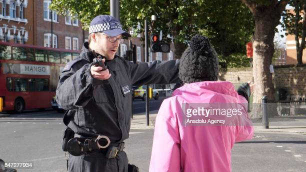 A police officer runs a security check on a person after an explosion at Parsons Green Tube Station in London United Kingdom on September 15 2017...