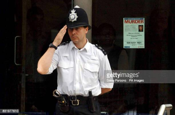 A police officer salutes the the funeral procession of murdered Special Constable Nisha PatelNasri as it makes it way makes it way past Wembley...