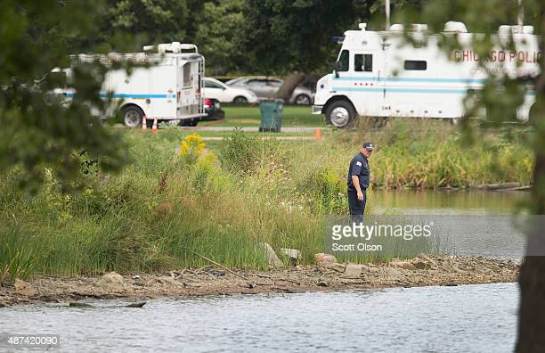 A police officer searches along the shoreline of the lagoon in Garfield Park for evidence after body parts from a toddler were recently discovered in...