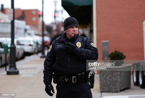 A police officer secures an area around the Buzz Westfall Justice Center in Clayton Missouri on November 24 2014 where a grand jury has been...