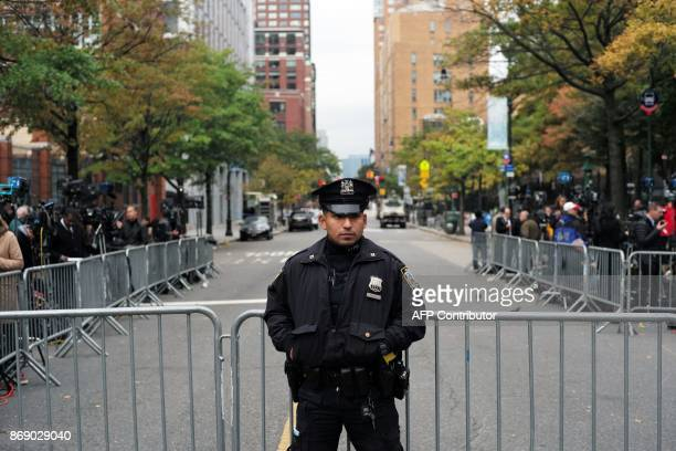 A police officer secures an area near the site of a terror attack in New York on November 1 2017 The pickup truck driver who plowed down a New York...