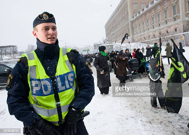 A Police officer secures on December 16 2010 near the Swedish Parliament in Stockholm a demonstration called by muslims community members to condemn...
