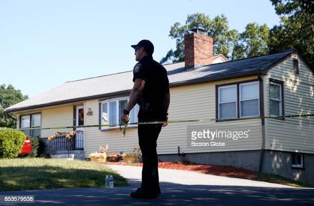 A police officer secures the crime scene tape outside of the home where the body of 30 year old Vanessa MacCormack was found in Revere MA on Sep 24...